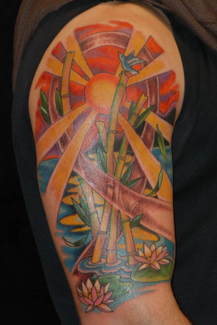 Awesome Colourful Sun and Bamboo Tree Tattoo