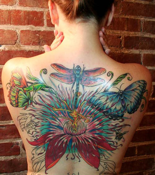 Awesome Butterfly Tattoo on Back of Lady