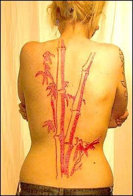 Red Bamboo Tree Tattoo on Back of Girl