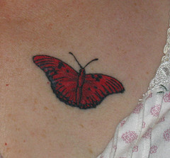 Cute and Lovely Red Butterfly Tattoo on Back of Lady