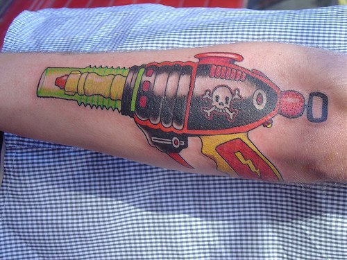 Alien Gun Tattoo On Arm