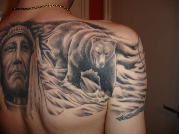 Bear World Tattoo On Arm And Back