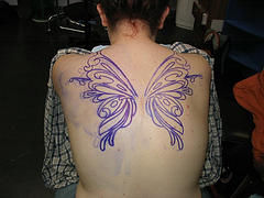 Cute Purple Butterfly Tattoo