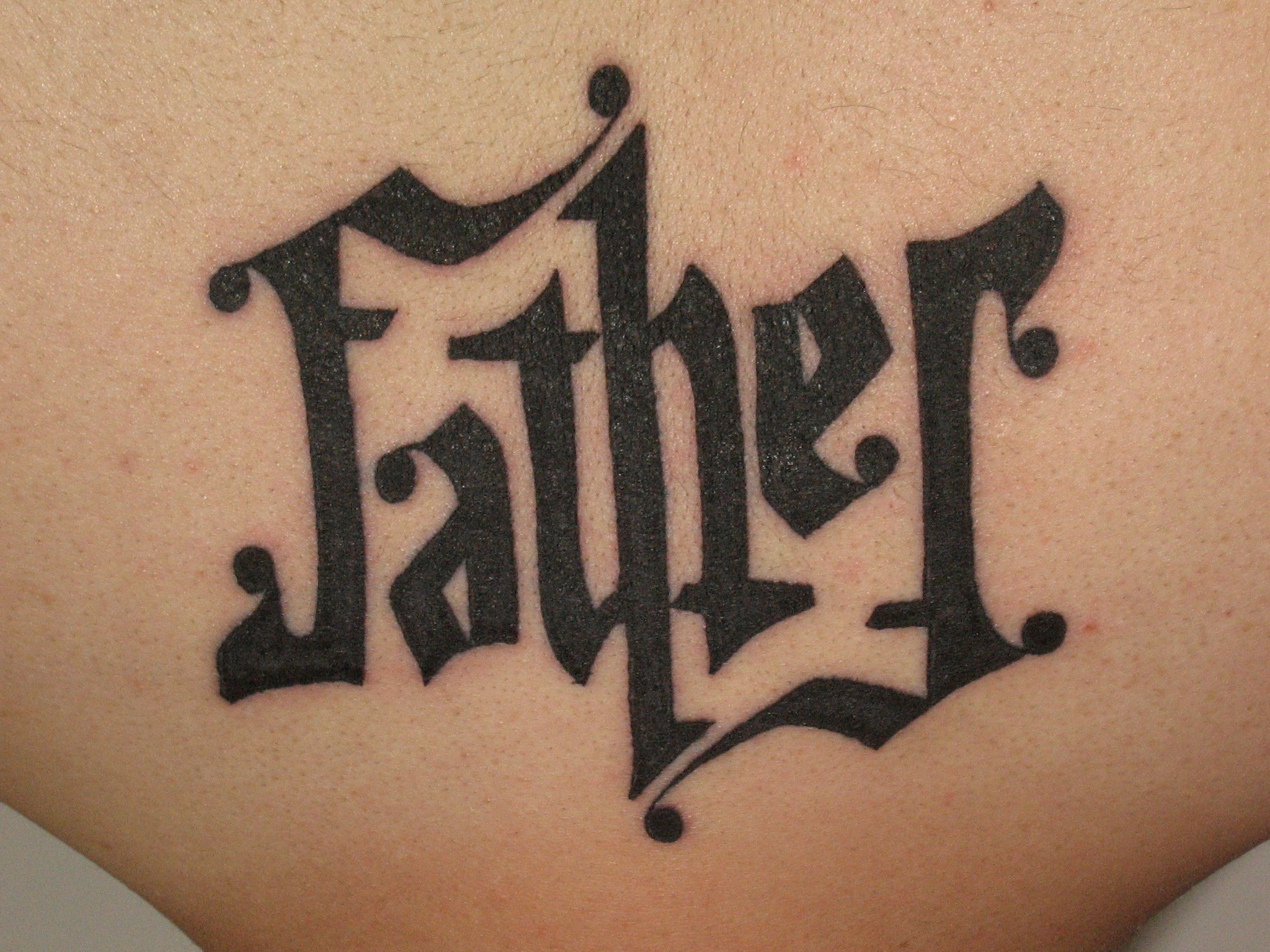 Father Ambigram Tattoo