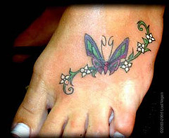 Small Cute Butterfly Tattoo On Foot