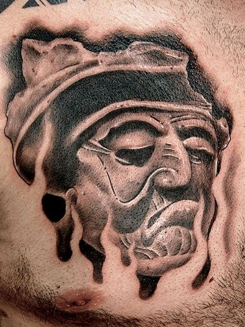African People Face Tattoo On Man Chest