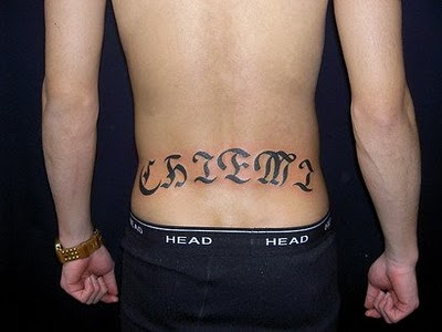 Attractive Ambigram Tattoo On Lower Back