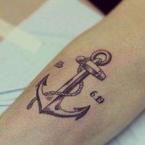 Awesome Anchor Symbol With Rope Tattoo
