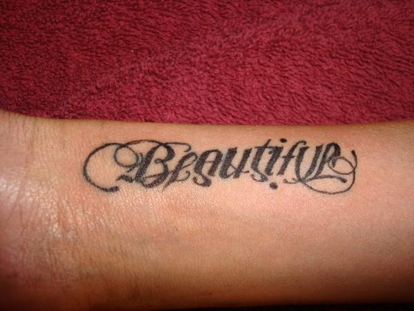 Beautiful Ambigram Tattoo Design On Arm