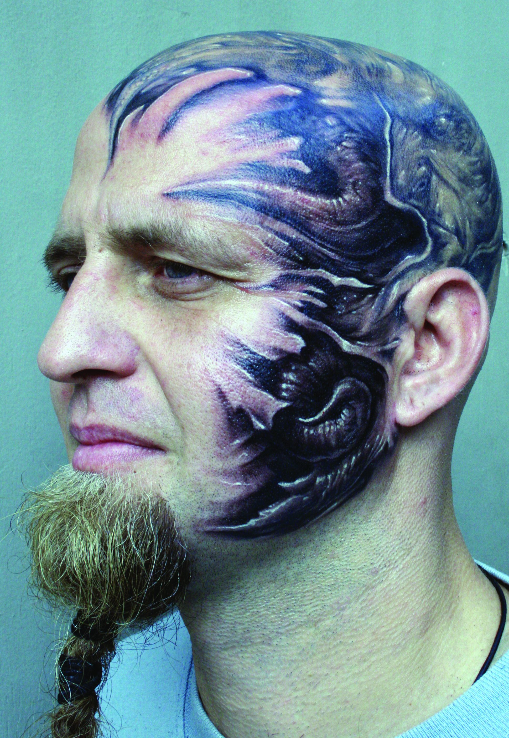 Biomechanical Alien Tattoo On Head And Face