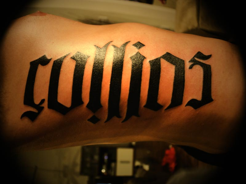 Collins Ambigram Tattoo On Rib