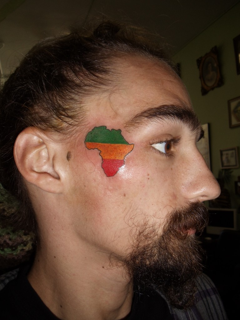 Colorful African Map Tattoo On Man Face