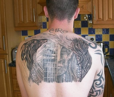 Fantastic Alien Tattoo On Upper Back