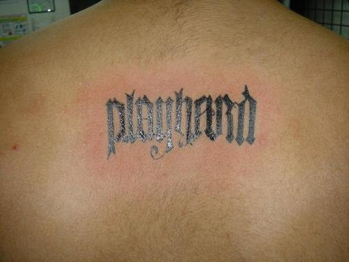 Play Hard Ambigram Tattoo On Back