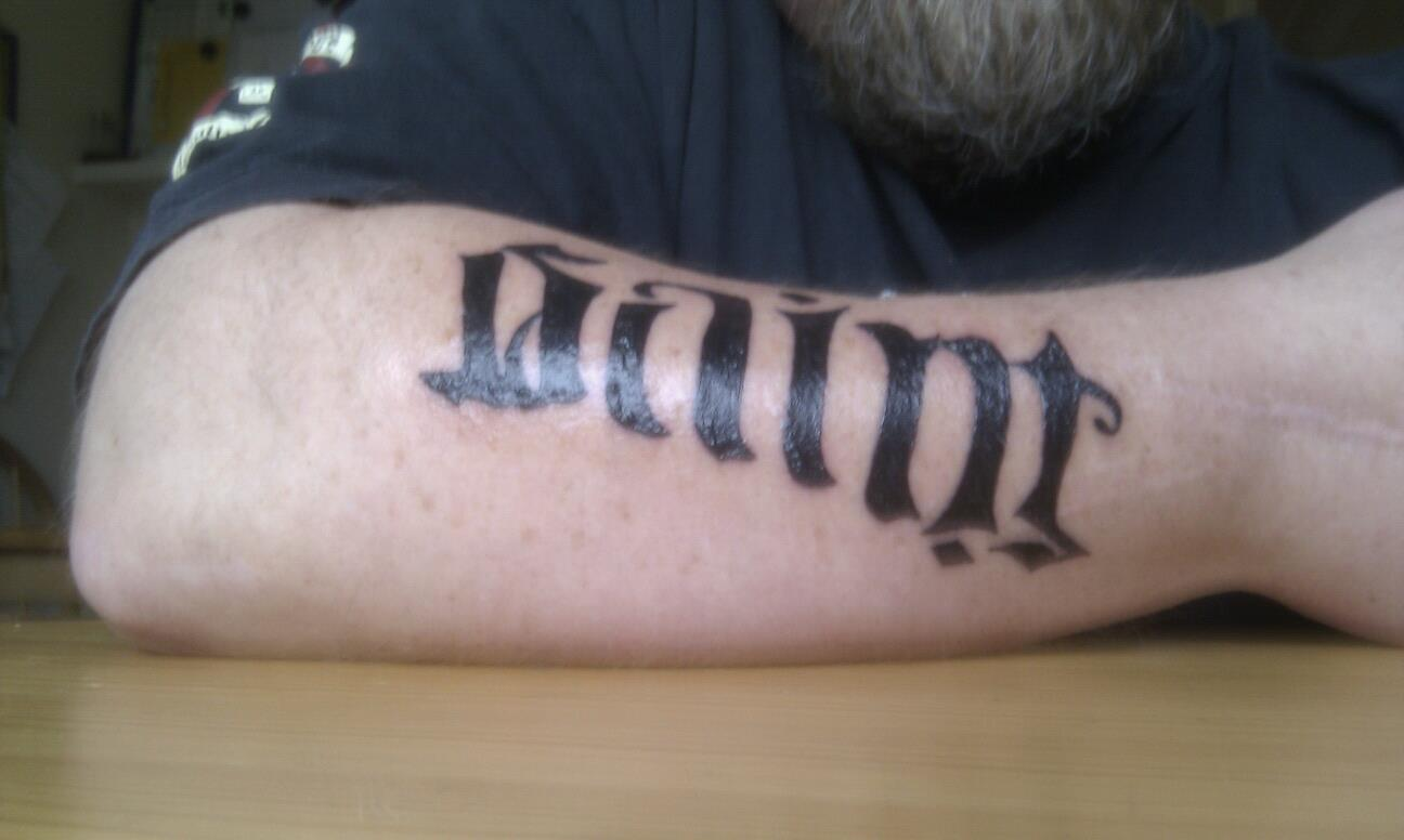 Saint Ambigram Tattoo On Arm