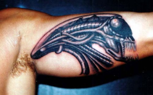 Scary Alien Face Tattoo On Arm