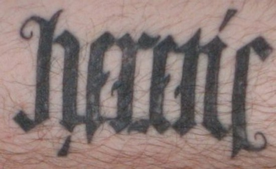 Unique Black Ink Ambigram Tattoo