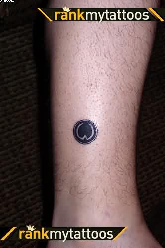 Tiny Black Ink Ankle Tattoo Design