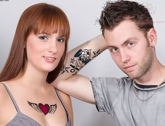 Winged Heart & Anchor Nautical Star Tattoo On Couple