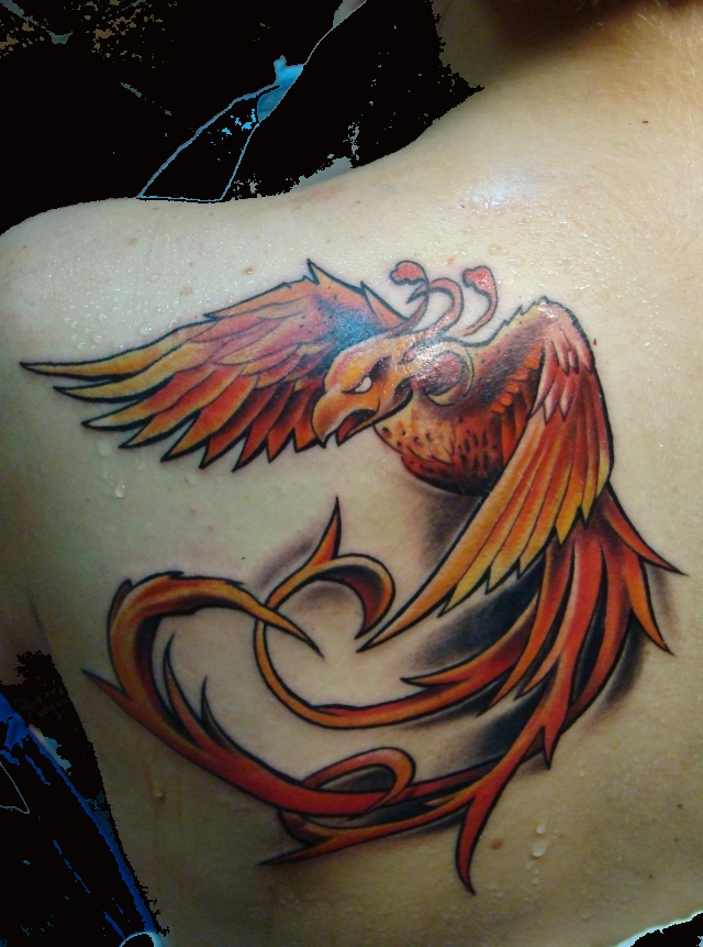 A Powerful Tattoo Design Of A Phoenix Bird In An Agressive Flying Pose