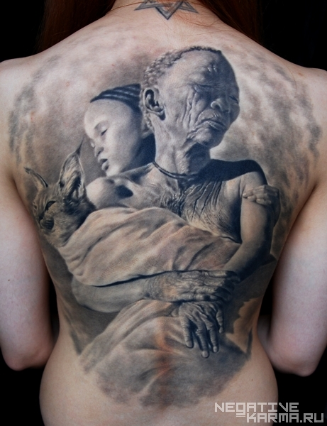 Woman Holding Cat and Child Tattoo On Back