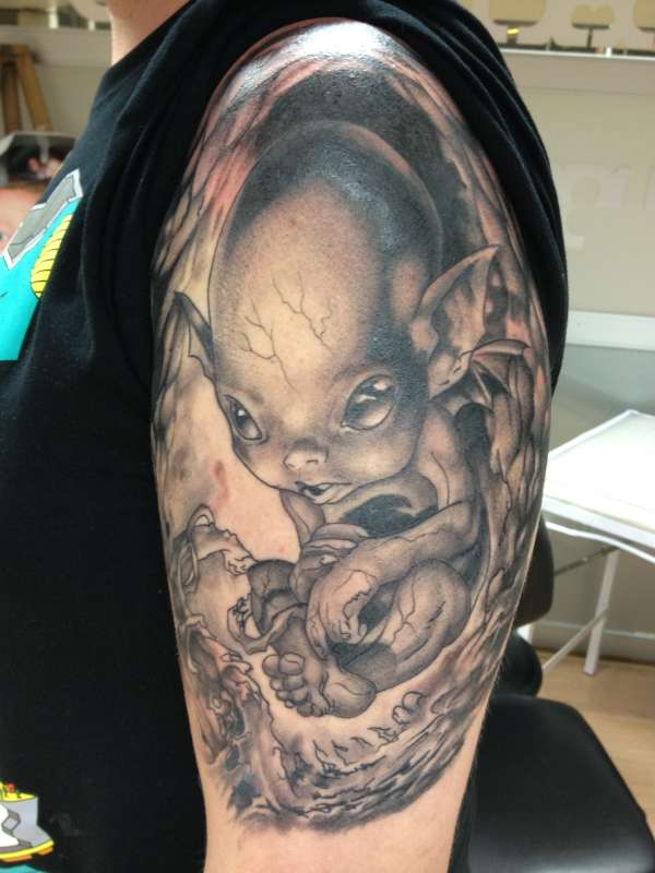 Baby Alien Tattoo On Muscles