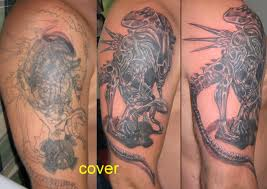 Alien Queen Cover Tattoo On Arms
