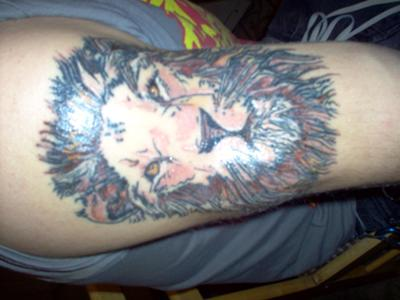 Lion Face Biceps Tattoo For Men