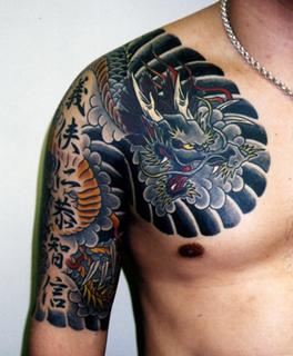 Attractive Asian Tattoo On Chest & Arm