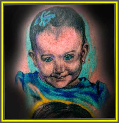 Attractive Baby Portrait Tattoo Design
