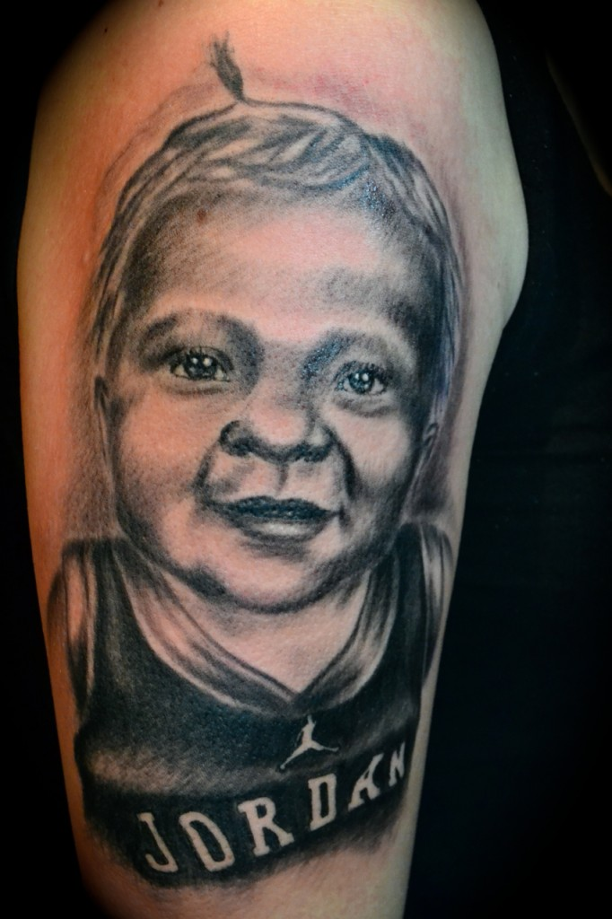 Awesome Baby Portrait Tattoo Design