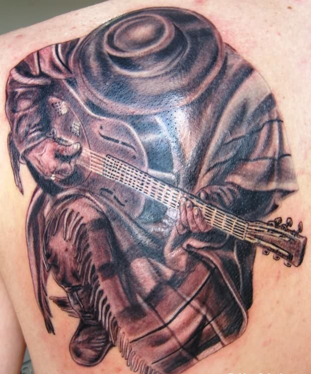 Band Man Playing Guitar Tattoo On Back
