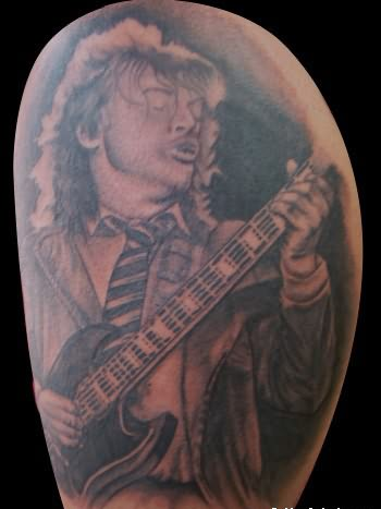 Band Player Playing Guitar Tattoo On Shoulder