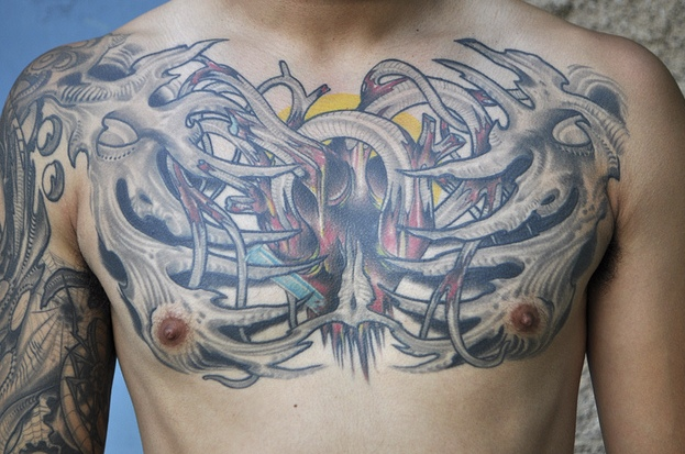 Biomechanical Heart & Skeleton Tattoo On Chest
