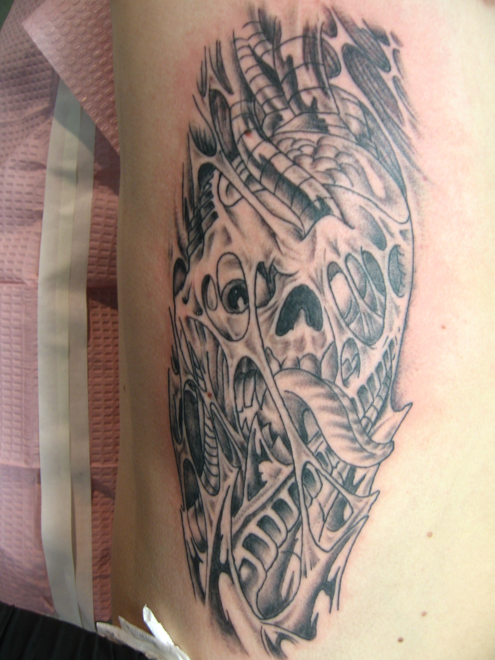 Biomechanical Tattoo On Rib Side