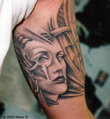 Biomechanical Woman Face Tattoo On Inner Biceps