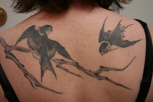 Black Ink Birds Tattoo On Upper Back