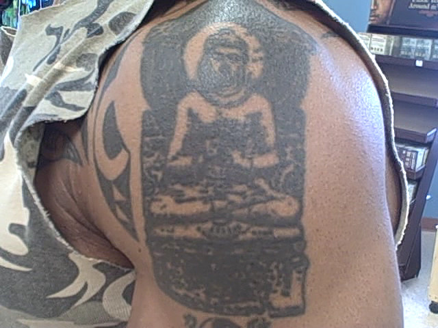 Black Ink Religious Buddha Tattoo On Biceps