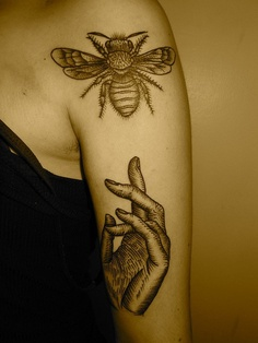 Bee & Hand Tattoo On Arm
