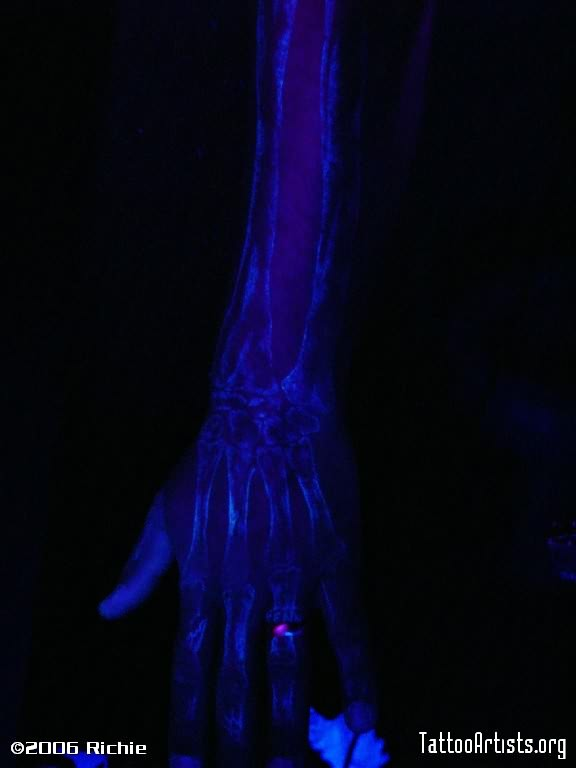 Blacklight Bones Tattoo On Arm