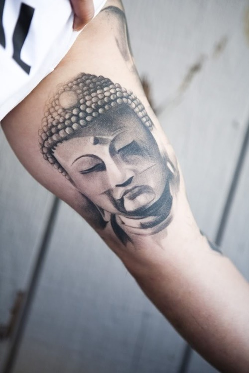 Buddha Face Tattoo On Muscles