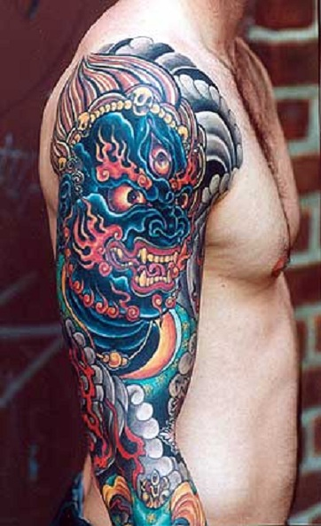 Whole Arm Angry Asian Dragon Tattoo