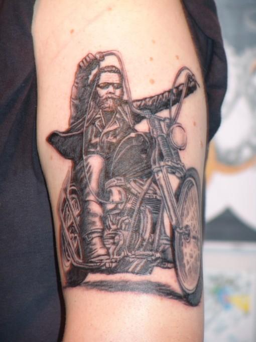 Cool Guy On Bike Tattoo