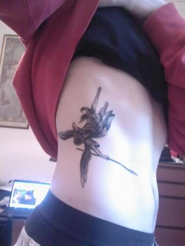 Falling Angel Tattoo On Rib