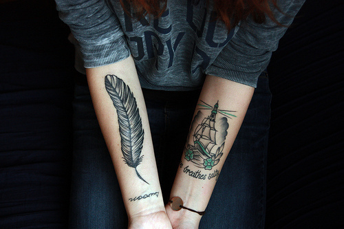 Feather & Pirate Ship Arm Tattoo Design