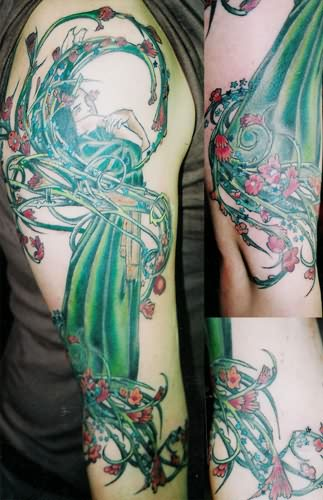 Full Arm Alien Tattoo With Green Ink