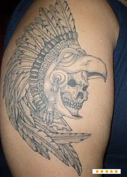 Grey Ink Aztec Skull Face Tattoo Design