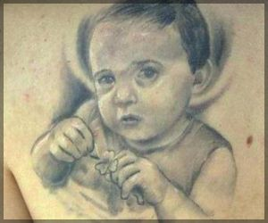 Grey Ink Baby Portrait Tattoo