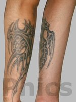 Grey Ink Biomechanical Tattoo On Leg