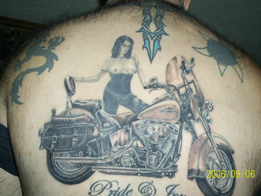 Hot Girl With Bike Tattoo On Back